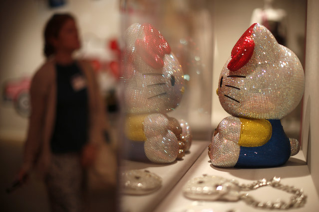 """People view the """"Hello! Exploring the Supercute World of Hello Kitty"""" museum exhibit in honor of Hello Kitty's 40th anniversary, at the Japanese American National Museum in Los Angeles, California October 10, 2014. (Photo by Lucy Nicholson/Reuters)"""