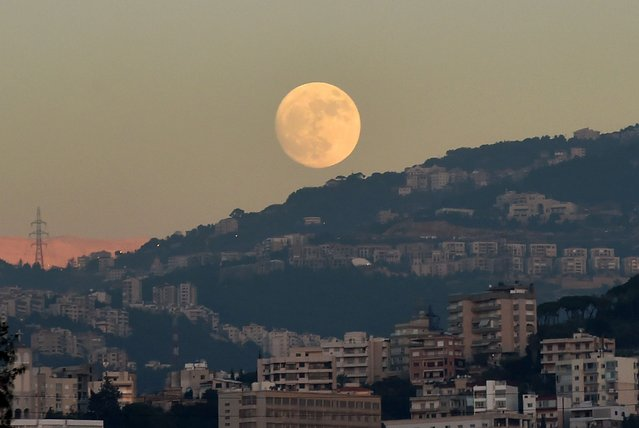 The full moon is seen on the sky over Beirut, Lebanon, 02 December 2017. (Photo by Wael Hamzeh/EPA/EFE/Rex Features/Shutterstock)
