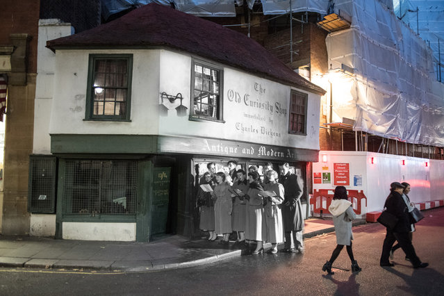 Archive: Students of King's College sing Christmas carols outside the Old Curiosity Shop, as immortalised by Charles Dickens on Portsmouth Street on December 12, 1956 in London, Engalnd. (Photo by Topical Press Agency/Getty Images) Modern Day: A general view of The Old Curiosity shop on November 24, 2014 in London, England. (Photo by Chris J. Ratcliffe/Getty Images)