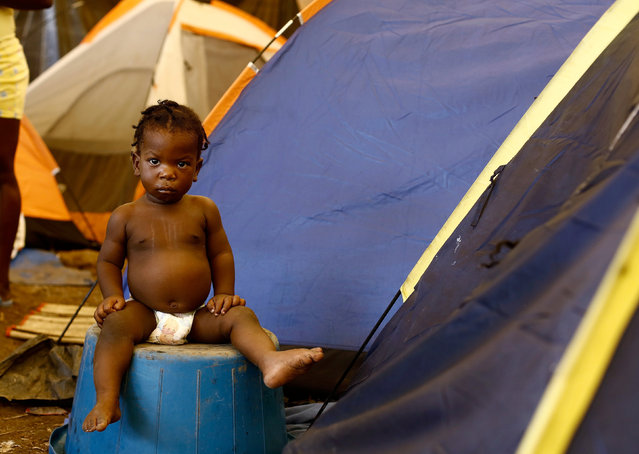 An African migrant child sits at a makeshift camp at the border between Costa Rica and Nicaragua, in Penas Blancas, Costa Rica, September 8, 2016. (Photo by Juan Carlos Ulate/Reuters)
