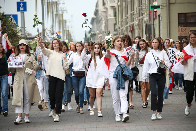 People take part in an opposition rally in Independence Avenue in Minsk, Belarus on August 20, 2020. Since the announcement of the 2020 Belarusian presidential election results on August 9, mass protests against the election results have been hitting major cities across Belarus. (Photo by Valery Sharifulin/TASS via Getty Images)