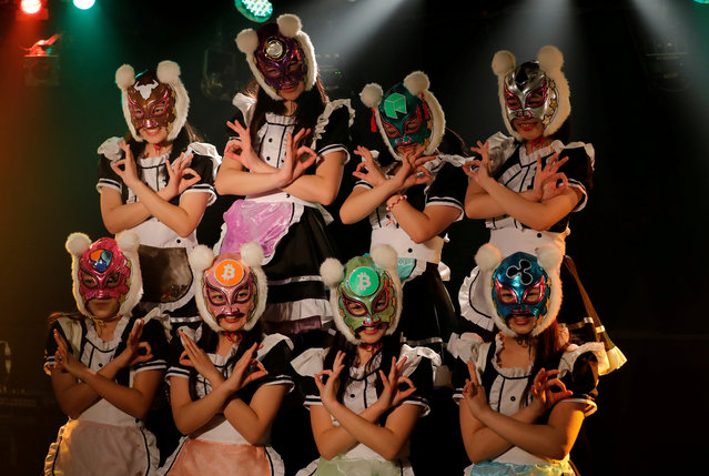 "Members of Japan's idol group ""Virtual Currency Girls"" wearing cryptocurrency-themed masks perform in their debut stage event in Tokyo, Japan, January 12, 2018. In their debut, the eight ""Virtual Currency Girls"", or Kasotsuka Shojo in Japanese, cavorted in maid costumes with frilly skirts and full-face professional wrestling-style masks with fuzzy pom-pom ears, extolling the virtues of decentralized digital currencies such as bitcoin. (Photo by Kim Kyung-Hoon/Reuters)"