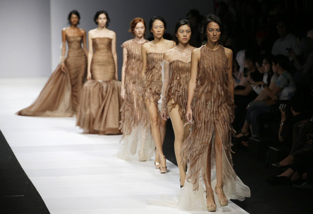 Models display creations by Veronica Vidyanita during the Jakarta Fashion Week 2015 in Jakarta, Indonesia, Thursday, November 6, 2014. (Photo by Achmad Ibrahim/AP Photo)