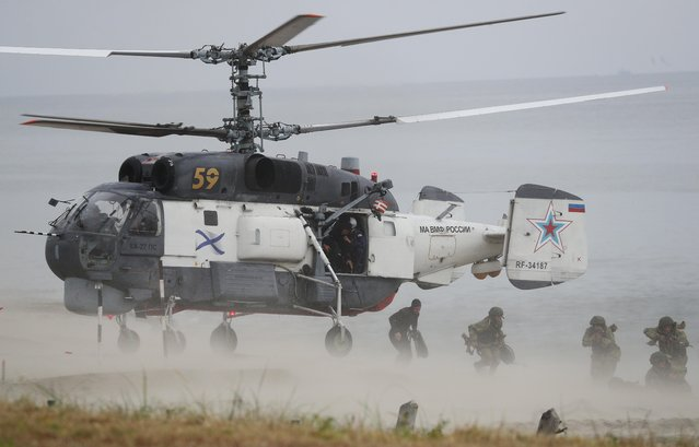 Russian marines disembark from a Kamov Ka-27PS military helicopter during the Ocean Shield 2020 naval exercise at the Khmelevka firing ground on the Baltic Sea coast in Kaliningrad Region, Russia on August 3, 2020. (Photo by Vitaly Nevar/Reuters)