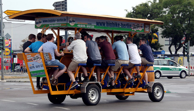 A so-called beer bike, where the participants cycle and can drink beer during the tour is pictured in Berlin, Germany September 17, 2016. (Photo by Fabrizio Bensch/Reuters)