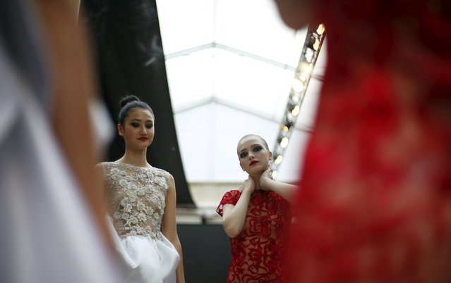 Models line up backstage before Nadir Tati show during Lisbon Fashion Week, Portugal October 11, 2015. (Photo by Rafael Marchante/Reuters)