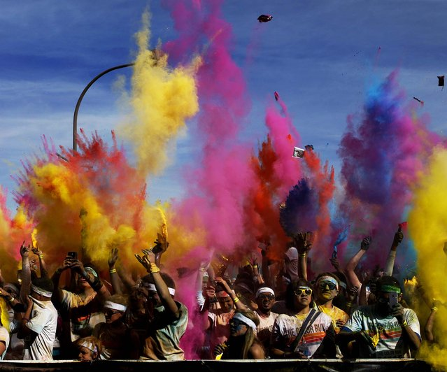 Participants in the Color Run Las Vegas throw colored powder into the air after participating in the run and walk on February 16, 2013. (Photo by John Locher/Las Vegas Review-Journal)
