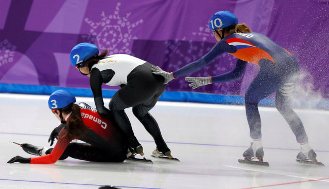 Annouk van der Weijden of the Netherlands, Ayano Sato of Japan and Ivanie Blondin of Canada fall at the Gangneung Oval in Gangneung, South Korea, 24 February 2018. (Photo by Phil Noble/Reuters)