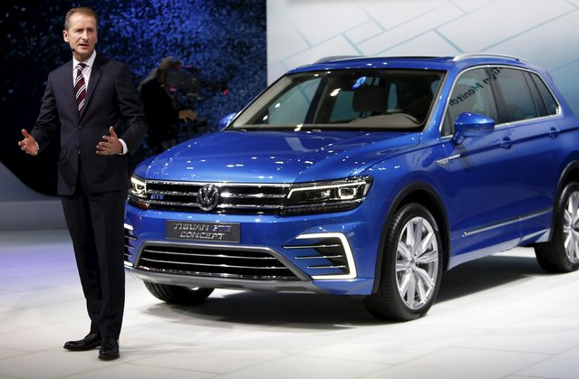 Herbert Diess, chairman of Volkswagen's passenger cars brand, speaks in front of its new Tiguan GTE during a presentation at the 44th Tokyo Motor Show in Tokyo, Japan, October 28, 2015. (Photo by Yuya Shino/Reuters)