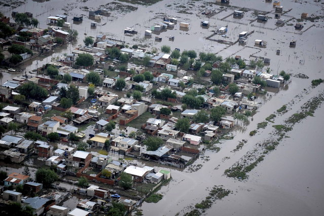 An aerial view of flooded streets is pictured after heavy rains in La Plata April 3, 2013. At least 46 people were killed in Argentina on Wednesday after a torrential downpour battered the eastern city of La Plata and forced some 2,200 people to flee their homes in search of dry ground. (Photo by Reuters/Infobae.com)