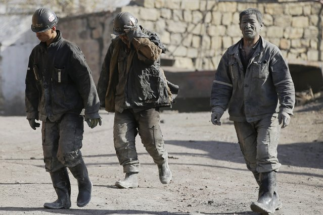 Miners walk at a coal mine from the state-owned Longmay Group on the outskirts of Jixi, in Heilongjiang province, China, October 24, 2015. (Photo by Jason Lee/Reuters)