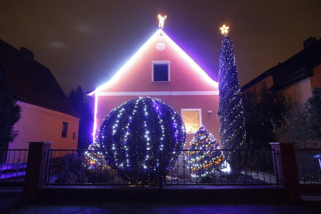 "A general view shows a so-called ""Lichterhaus"" (light house) with Christmas decorations and lights in Berlin, December 10, 2014. (Photo by Fabrizio Bensch/Reuters)"