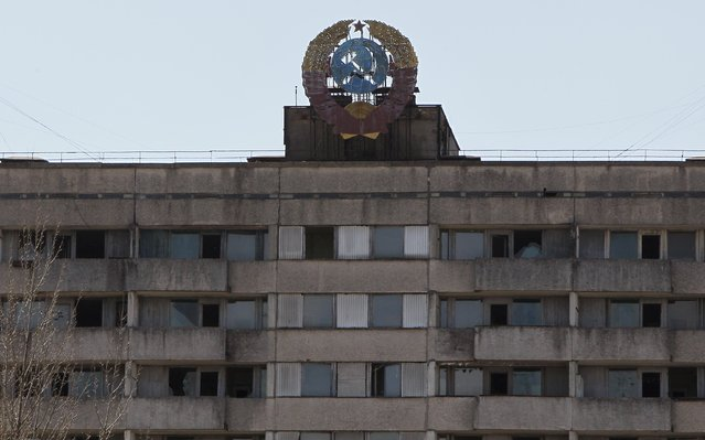 The coat of arms of the former Soviet Union is seen on the roof of a house in the abandoned city of Pripyat near Chernobyl nuclear power plant April 23, 2013. Ukraine will mark the 27th anniversary of the Chernobyl disaster, the world's worst civil nuclear accident, on April 26. (Photo by Gleb Garanich/Reuters)
