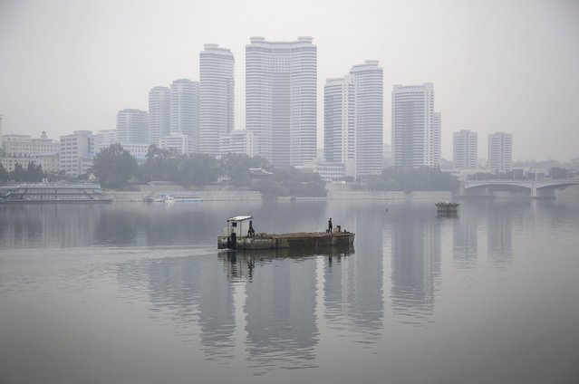 Residential buildings along Changjong Street which form part of the Pyongyang skyline are seen reflected in the Taedong River on a misty morning on Sunday, October 16, 2016, in Pyongyang, North Korea. (Photo by Wong Maye-E/AP Photo)