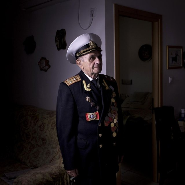 In this photo made Thursday, April 18, 2013, Soviet Jewish World War Two veteran Orlov Naum, 88, poses for a portrait at his house in central Israeli city of Rishon Lezion. Naum joined the Red Army in 1943 after two years of evacuation from Odessa in Kazahstan. He served in 3rd Guard Tank Army at the Voronezh front as an infantry soldier and took part in battle of Kiev and later in battles in Berlin and Prague. During the last days of the war, he was in Prague. After the war, he continued military service in the Navy, served in cruisers Nahimov and Kuibyshev. He immigrated to Israel from Kishinev in 1990. About 500,000 Soviet Jews served in the Red Army during World War Two, and the majority of those still alive today live in Israel. (Photo by Oded Balilty/AP Photo)
