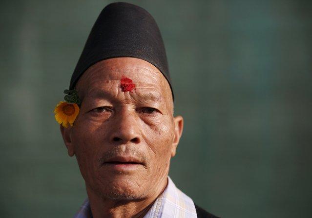 A Newari man takes part in the Newari New Year parade that falls during the Tihar festival, also called Diwali, in Kathmandu, Nepal November 12, 2015. (Photo by Navesh Chitrakar/Reuters)