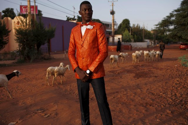 A model poses for a picture in a bazin suit made by designer Barros Coulibaly in Bamako, Mali, October 21, 2015. (Photo by Joe Penney/Reuters)