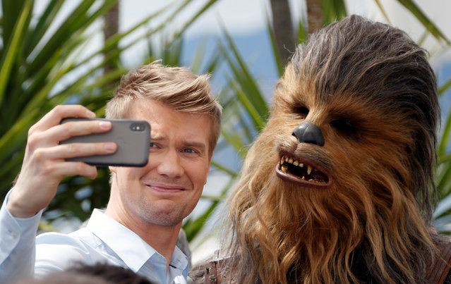 """Cast member Joonas Suotamo takes a selfie with Chewbacca as they arrive on May 15, 2018 for the screening of the film """"Solo : A Star Wars Story"""" at the 71 st edition of the Cannes Film Festival in Cannes, southern France. (Photo by Eric Gaillard/Reuters)"""