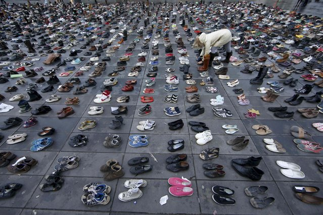 Pairs of shoes are symbolically placed on the Place de la Republique, after the cancellation of a planned climate march following shootings in the French capital, ahead of the World Climate Change Conference 2015 (COP21), in Paris, France, November 29, 2015. (Photo by Eric Gaillard/Reuters)
