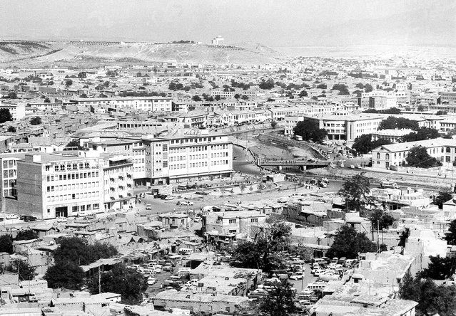 A panoramic view showing the old and new buildings in Kabul, in August of 1969. The Kabul River flows through the city, center right. In the background on the hilltop is the mausoleum of late King Mohammad Nadir Shah. (Photo by AP Photo via The Atlantic)