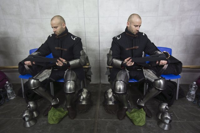 """A competitor from Denmark is seen at the dressing room during the """"World Medieval Fighting Championship – the Israeli Challenge"""" in Rishon Letzion near Tel Aviv on January 22, 2015. (Photo by Amir Cohen/Reuters)"""