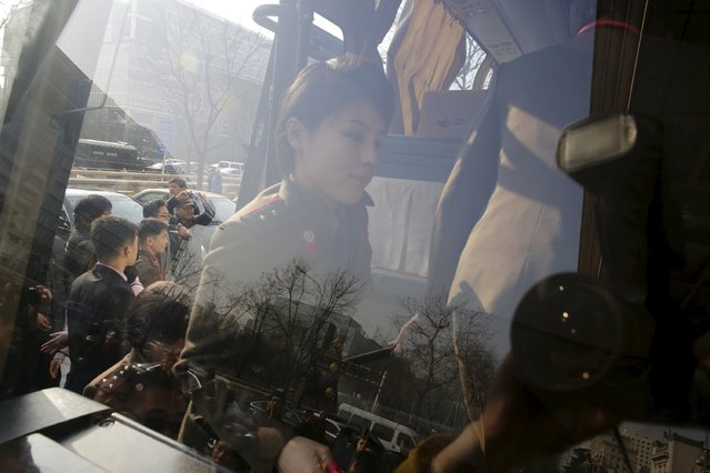 A member of the Moranbong Band from North Korea gets on a bus as she leaves a hotel in central Beijing, China, December 11, 2015. (Photo by Reuters/Stringer)