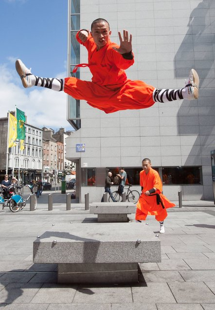 Members of the Chinese Shaolin Buddhist monks in full traditional dress during a performance beside the Olympia Theatre, Dublin, on July 4, 2013. (Photo by  Gareth Chaney Collins)