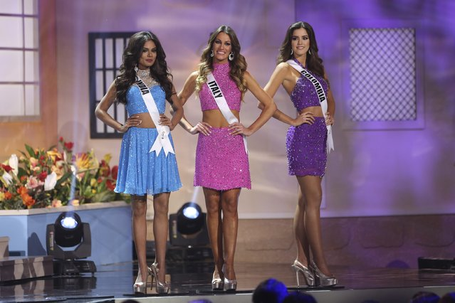 Miss India Noyonita Lodh, Miss Italy Valentina Bonariva, and Miss Colombia Paulina Vega onstage during The 63rd Annual Miss Universe Pageant at Florida International University on January 25, 2015 in Miami, Florida. (Photo by Alexander Tamargo/Getty Images)