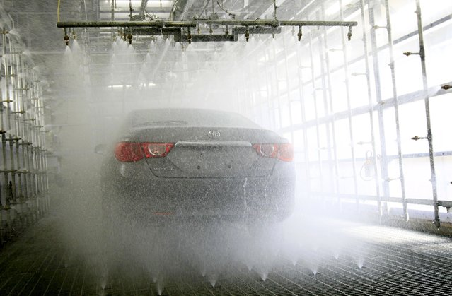 A Toyota Motor Corp car is seen during a hi-function shower test demonstration at the quality-control facility in Toyota, central Japan in this March 30, 2010 file photo. Japan is expected to release industrial output data this week. (Photo by Kim Kyung-Hoon/Reuters)