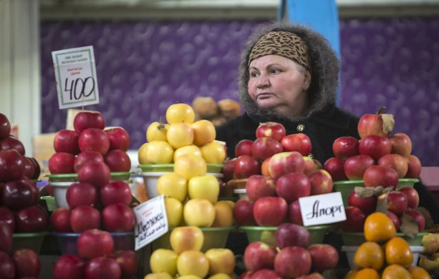 A vendor sells fruit at the Green Bazaar in Almaty January 23, 2015. (Photo by Shamil Zhumatov/Reuters)