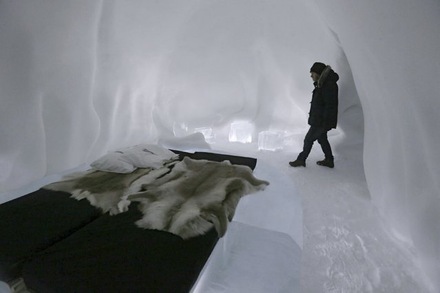 A man walks into a room in the Ice hotel in Jukkasjarvi, Sweden, December 16, 2015. (Photo by Ints Kalnins/Reuters)