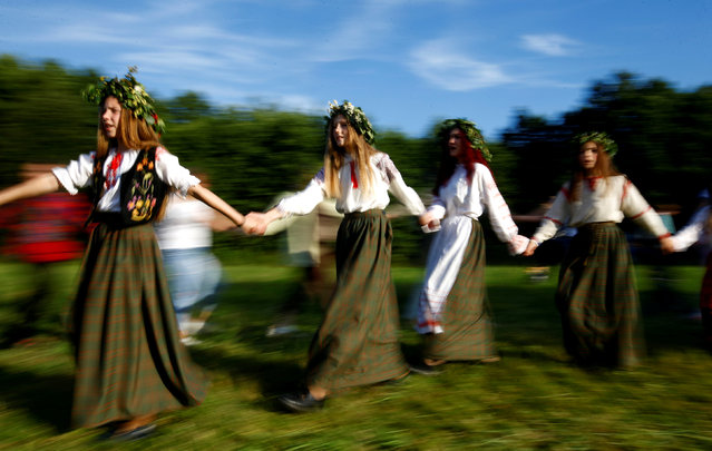 Belarusian women take part in the Ivan Kupala festival in Belarusian state museum of folk architecture and rural lifestyle near the village Aziarco, Belarus, July 7, 2018. (Photo by Vasily Fedosenko/Reuters)