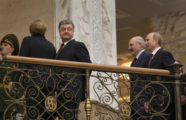 Ukrainian President Petro Poroshenko, left, is followed by Russian President Vladimir Putin, right, and Belarusian President Alexander Lukashenko, heading for a broader meeting involving senior officials in Minsk, Belarus, Wednesday, February 11, 2015. (Photo by Sergei Grits/AP Photo)