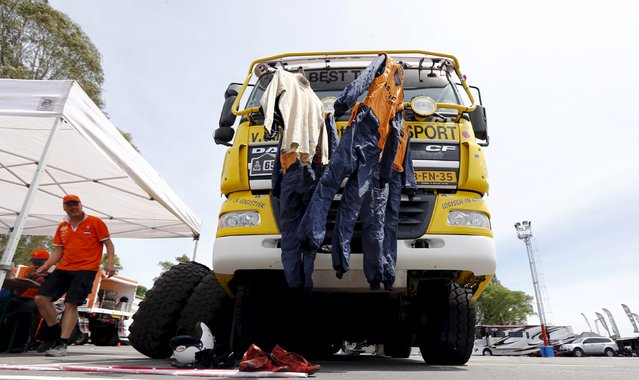 Truck pilots' suits are hung out to dry on the front of a truck outside the technical verification area ahead of the Dakar Rally 2016 in Buenos Aires, Argentina, December 31, 2015. (Photo by Marcos Brindicci/Reuters)