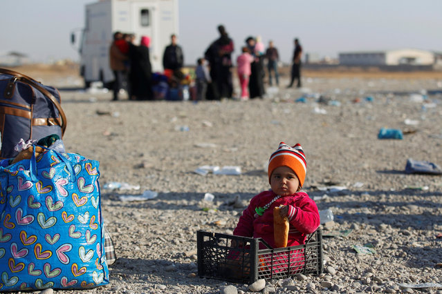 A displaced Iraqi child, who fled the Islamic State stronghold of Mosul, is seen on the outskirts of Mosul, Iraq, November 28, 2016. (Photo by Khalid al Mousily/Reuters)