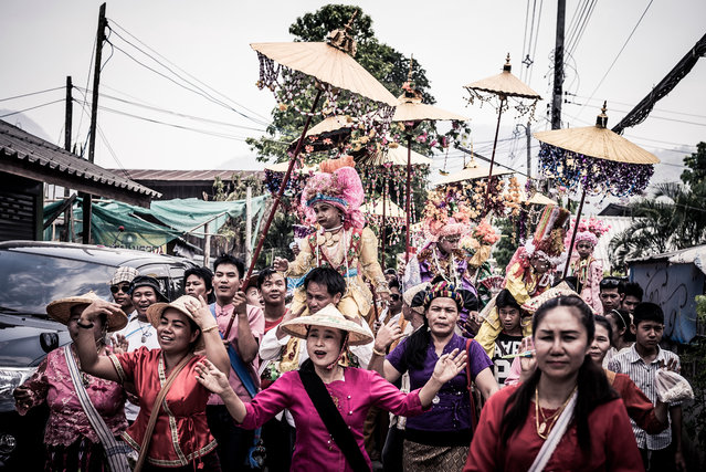The initiates are led through town by drummers and their families in Mae Hong Son, Thailand, April 2016. (Photo by Claudio Sieber/Barcroft Images)