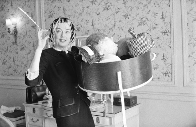 American actress Rosalind Russell (1907 – 1976) holding a collection of hats, 22nd August 1958. (Photo by McKeown/Daily Express/Hulton Archive/Getty Images)