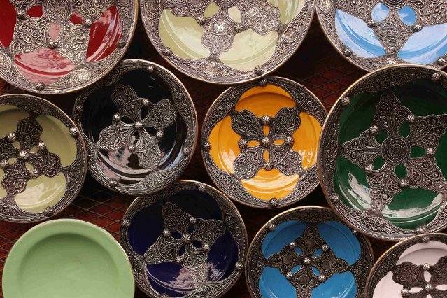 A view of traditional plates at a pottery workshop in the old Medina in the city of Marrakech December 10, 2014. (Photo by Youssef Boudlal/Reuters)