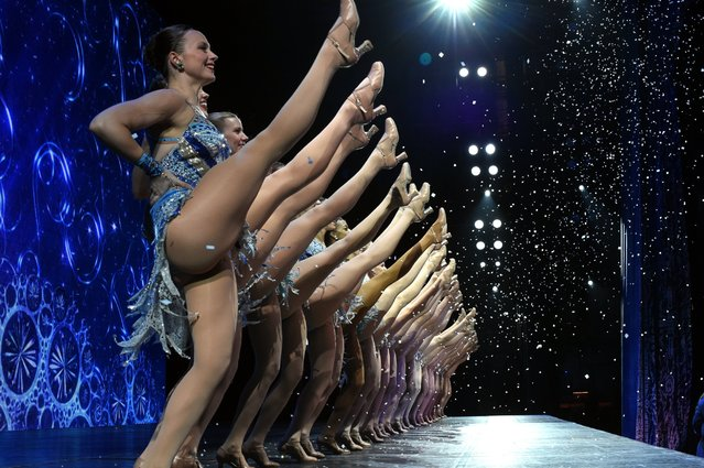 A view from backstage as the Rockettes perform a number during the 2015 Radio City Christmas Spectacular at Radio City Music Hall on December 2, 2015. (Photo by Timothy A. Clary/Getty Images)