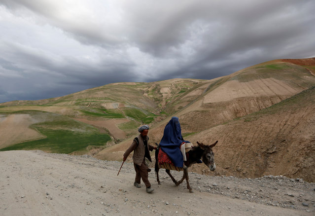 An Afghan family travels with a donkey in the Argo district in Badakhshan province May 5, 2014. (Photo by Mohammad Ismail/Reuters)