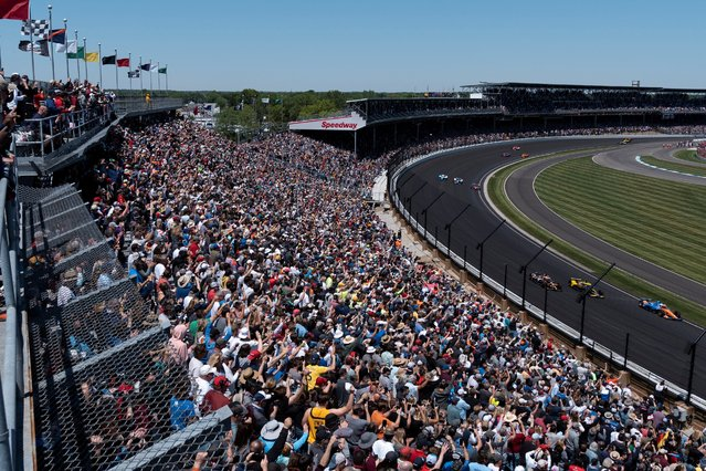 Spectators react as drivers take their first lap at the Indy 500, the largest attended sporting event in the world since the start of the coronavirus disease (COVID-19) pandemic, in Indianapolis, Indiana, U.S., May 30, 2021. (Photo by Cheney Orr/Reuters)