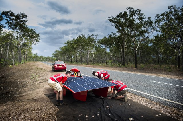 A handout image of the Red Engine Team obtained on 04 October 2013 shows the Red Engine going for a test drive around Darwin, Australia, 21 September 2013. The Dutch vehicle is competing in the World Solar Challenge, driving from Darwin to Adelaide starting on 06 October 2013. (Photo by Joost Van Baars/EPA/Red Engine Team)