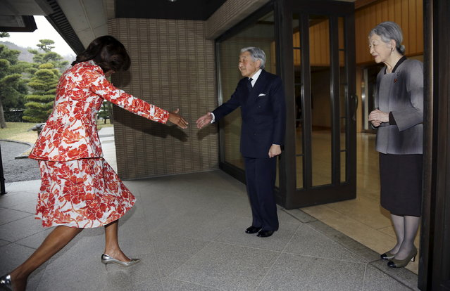 U.S. first lady Michelle Obama (L) gets caught a bump before shaking hand with Emperor Akihito (C) and Empress Michiko at the Imperial Palace in Tokyo March 19, 2015. Michelle Obama flew in to Japan on Wednesday for a three-day visit as part of the Let Girls Learn international girls education initiative. (Photo by Eugene Hoshiko/Reuters)