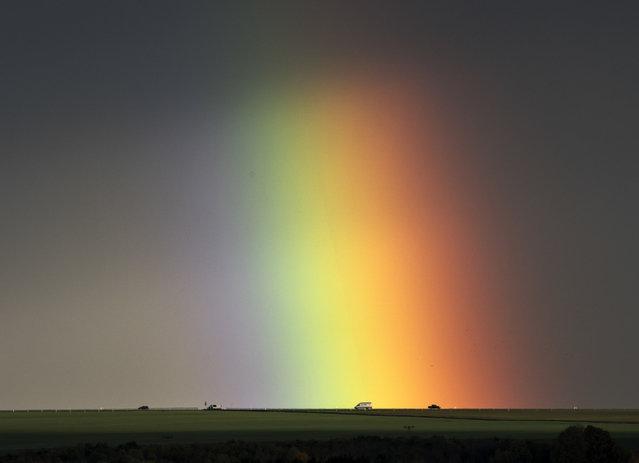 Cars drive under a rainbow near Bad Langensalza, Germany, Wednesday, November 2, 2016. (Photo by Jens Meyer/AP Photo)