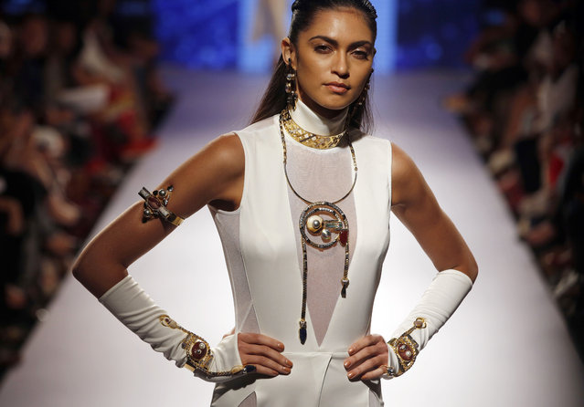 A model walks the ramp during the Valliyan by Nitya show at the Lakme Fashion Week Summer Resort 2015 in Mumbai, India, Friday, March 20, 2015. (Photo by Rajanish Kakade/AP Photo)