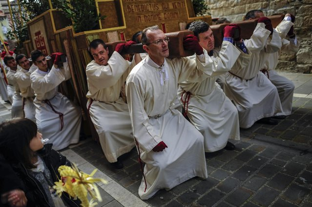 Penitents take part in a procession during Palm Sunday few days prior to Holy Week, in Pamplona northern Spain, Sunday, March 29, 2015. Spain's devoted Catholics take part in a lot of religious ceremonies during Holy Week. (Photo by Alvaro Barrientos/AP Photo)