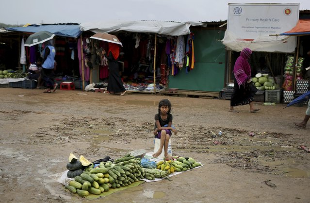 In this August 28, 2018, photo, a Rohingya refugee girl sells vegetables in Kutupalong refugee camp, Bangladesh. (Photo by Altaf Qadri/AP Photo)