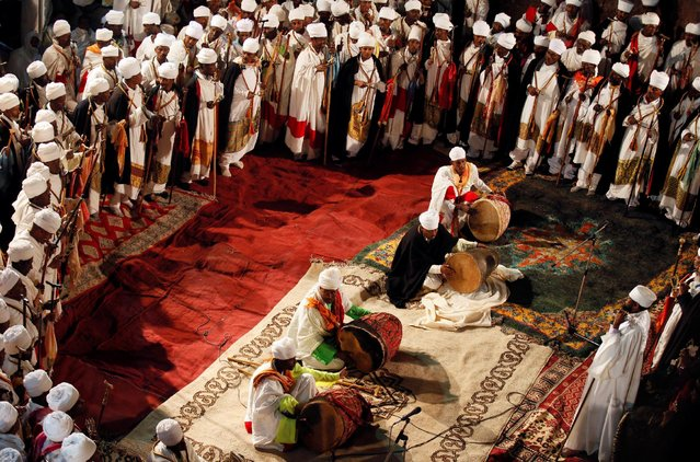 Ethiopian Orthodox choir members perform during the Ethiopian Christmas Eve celebration in Bete Maryam (House of Mary) monolithic church in Lalibela, Ethiopia January 6, 2017. Picture taken January 6, 2017. (Photo by Tiksa Negeri/Reuters)