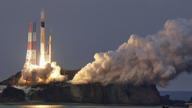 """A H-IIA rocket, carrying X-ray astronomy satellite """"ASTRO-H"""", lifts off from the launch pad at Tanegashima Space Center on the Japanese southwestern island of Tanegashima, in this photo taken by Kyodo February 17, 2016. (Photo by Reuters/Kyodo News)"""