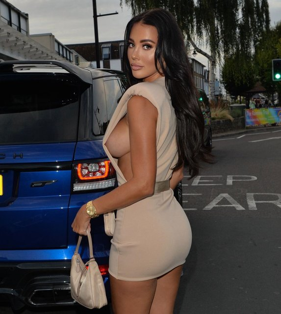 """""""The Only Way Is Essex"""" star Yazmin Oukhellou, 27, showed off her toned figure in the minidress, which featured sеxy side cut-outs, as she headed out in Hertfordshire in southern Englandon on Saturday, August 14, 2021. (Photo by Splash News and Pictures)"""